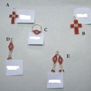 Pendenti e orecchini tessiti in corallo rosso
