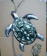 Decorazione da muro con tartarughe metallo