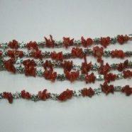 Bracciali in corallo con elementi metallo
